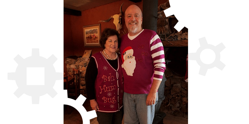Todd and Julie Ramsey wearing ugly Christmas sweaters.